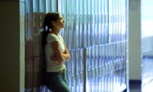 teen-standing-against-lockers