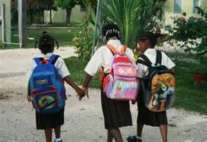 Three children walk to school together.