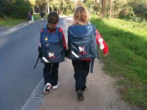 Two children walk to school together.