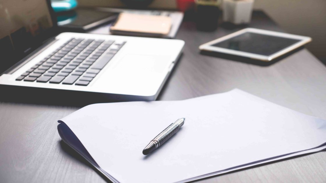 laptop, ipad & pen on a desk